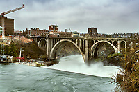 The beautiful Monroe Street Bridge spanning the, brimming with spring flow, Spokane River in downtown Spokane Washington.