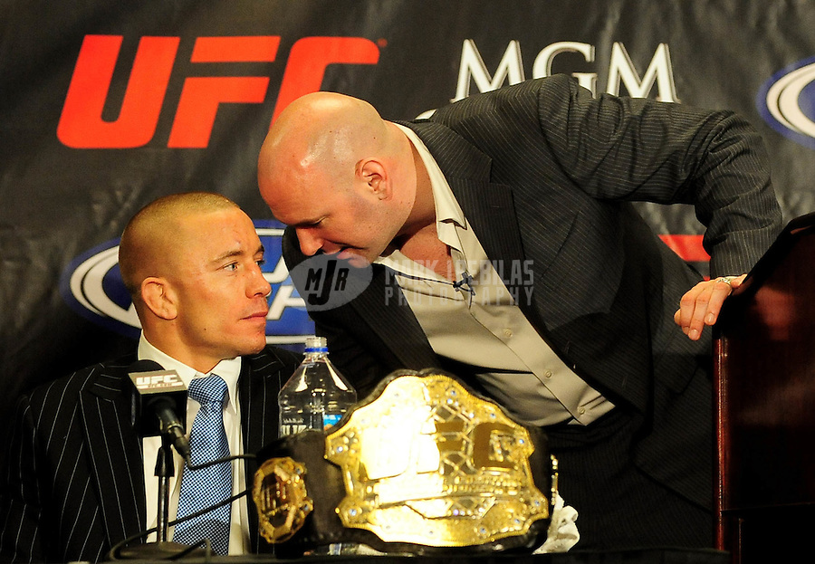 Jan. 31, 2009; Las Vegas, NV, USA; UFC fighter Georges St-Pierre speaks with UFC commissioner Dana White after defeating B.J. Penn (not pictured) during the welterweight championship in UFC 94 at the MGM Grand Hotel and Casino. St-Pierre defeated Penn with a fourth round TKO. Mandatory Credit: Mark J. Rebilas-