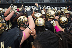 The Wake Forest Demon Deacons huddle up prior to the game against the Louisville Cardinals at BB&T Field on October 28, 2017 in Winston-Salem, North Carolina.  The Demon Deacons defeated the Cardinals 42-32.  (Brian Westerholt/Sports On Film)