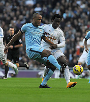 Picture: Andrew Roe/AHPIX LTD, Football, Barclays Premier League, Manchester City v Swansea City, 22/11/14, Etihad Stadium, K.O 3pm<br /> <br /> City's Vincent Kompant is closed down by Swansea's Wilfried Bony<br /> <br /> Andrew Roe>>>>>>>07826527594