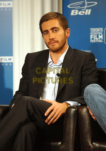 "JAKE GYLLENHAAL .at the press conference for his new film ""Rendition"" during the 32nd Annual Toronto International Film Festival, Toronto, Canada, .7th September 2007..half length sitting shirt suit beard bored expression.CAP/TL.©Tony Lee/Capital Pictures."