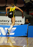 Magic centre Laura Langman stumbles through the advertising signage during the ANZ Netball Championship match between the Waikato Bay of Plenty Magic and Adelaide Thunderbirds, Mystery Creek Events Centre, Hamilton, New Zealand on Sunday 19 July 2009. Photo: Dave Lintott / lintottphoto.co.nz