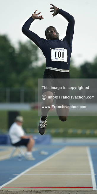 Windsor, ON. JULY 27, 2006. - Kadeem Douglas makes his last jump during the male juvenile long jump event during the male 1500 meters at the first day of competition of the Ontario Track and Field Association Super-Meet at the University of Windsor stadium Friday July 28, 2006. Douglas finish second and won the silver medal. (Windsor Star - Francis Vachon)<br />