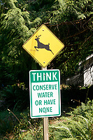 Deer crossing and conserve water sign on Bowen Island near Vancouver, British Columbia, Canada
