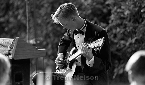 Todd Robinson with guitar at Amberly and Bruce's wedding.<br />
