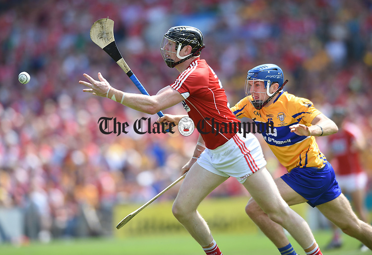 Damien Cahalane of Cork in action against Shane O Donnell of Clare during their Munster senior hurling final at Thurles. Photograph by John Kelly.