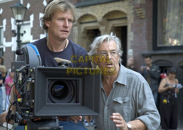 KARL WALTER (DIRECTOR OF PHOTOGRAPHY) & PAUL VERHOVEN (DIRECTOR).on the set of Black Book (Zwartboek) .**Editorial Use Only**.CAP/FB.Supplied by Capital Pictures