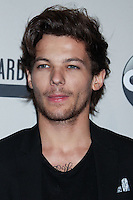 LOS ANGELES, CA - NOVEMBER 24: Louis Tomlinson of One Direction in the press room at the 2013 American Music Awards held at Nokia Theatre L.A. Live on November 24, 2013 in Los Angeles, California. (Photo by Celebrity Monitor)