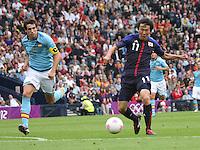 Men's Olympic Football match Spain v Japan on 26.7.12...Kensuke Nagai of Japan and Javier Martinez of Spain, during the Spain v Japan Men's Olympic Football match at Hampden Park, Glasgow.........