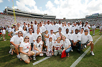 TALLAHASSEE, FL 9/26/09-FSU-USF FB09 CH51-Members of the Florida State 1999 national championship football team and their families pose for a photo after being honored prior to the South Florida game Saturday at Doak Campbell Stadium in Tallahassee. ..COLIN HACKLEY PHOTO