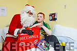 Children from the Cashel Ward in University Hospital Kerry were delighted to Santa stop by on Friday afternoon. Pictured were: Santa with Jason O'Connor from Milltown.