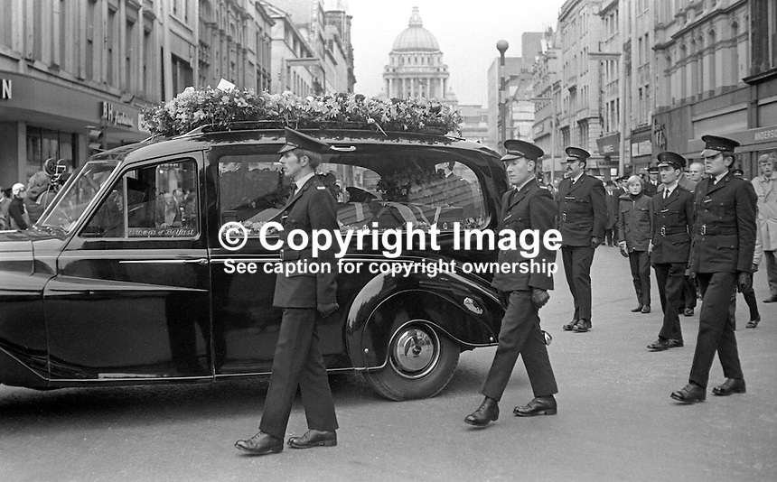 Funeral of Constable David Montgomery passes through the city centre in Belfast, N Ireland on 29th January 1972. Constable Mongomery, along with another police officer, Sergeant Peter Gilgun, died in a Provisional IRA gun attack on 27th January 1972 on Creggan Road, Londonderry.  Constable Montgomery had been due for a transfer from Londonderry but had been allowed to stay on until June when he planned to marry a 19 year old local girl. 197201290063a<br /> <br /> Copyright Image from Victor Patterson, 54 Dorchester Park, Belfast, UK, BT9 6RJ<br /> <br /> t1: +44 28 9066 1296 (from Rep of Ireland 048 9066 1296)<br /> t2: +44 28 9002 2446 (from Rep of Ireland 048 9002 2446)<br /> m: +44 7802 353836<br /> <br /> e1: victorpatterson@me.com<br /> e2: victorpatterson@gmail.com<br /> <br /> www.victorpatterson.com<br /> <br /> IMPORTANT: Please see my Terms and Conditions of Use at www.victorpatterson.com