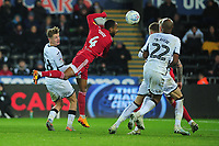 George Byers of Swansea City battles with Denis Odoi of Fulham during the Sky Bet Championship match between Swansea City and Fulham at the Liberty Stadium in Swansea, Wales, UK. Friday 29 November 2019