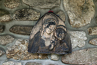 Madonna and child carving against the fieldstone wall of a monastic church, St Joesph Trappist Abbey, Spencer, Massachusetts, USA.