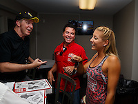 Sep 3, 2016; Clermont, IN, USA; NHRA top fuel driver Leah Pritchett (right) with Papa Johns pizza founder John Schnatter (center) and NHRA president Peter Clifford during qualifying for the US Nationals at Lucas Oil Raceway. Mandatory Credit: Mark J. Rebilas-USA TODAY Sports