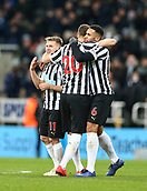 29th January 2019, St James Park, Newcastle upon Tyne, England; EPL Premier League football, Newcastle United versus Manchester City; Matt Ritchie Florian Lejeune and Jamaal Lascelles of Newcastle United hug at the end of their 2-1 win