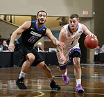SIOUX FALLS, SD - MARCH 12:  Gibson Berryhill #1 from the College of Idaho gets a step past Chandler White #10 from St. Francis during their semifinal game at the 2018 NAIA DII Men's Basketball Championship at the Sanford Pentagon in Sioux Falls. (Photo by Dave Eggen/Inertia)