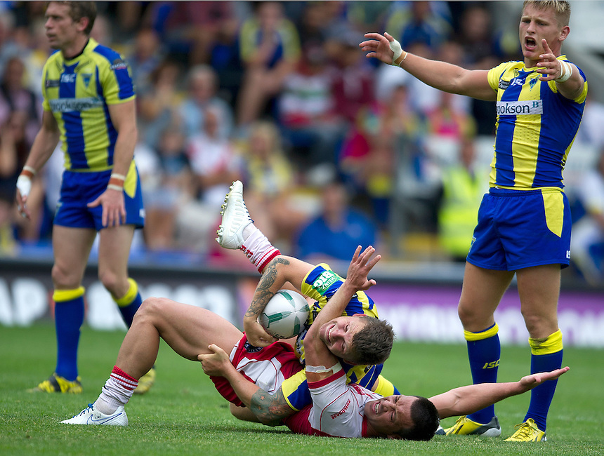 Warrington Wolves' Lee Briers is tackled by Hull Kingston Rovers' Lincoln Withers<br /> <br />  (Photo by Stephen White/CameraSport) <br /> <br /> Rugby League - Super League - Warrington Wolves v Hull Kingston Rovers - Sunday 21st July 2013 - Halliwell Jones Stadium - Warrington<br /> <br /> &copy; CameraSport - 43 Linden Ave. Countesthorpe. Leicester. England. LE8 5PG - Tel: +44 (0) 116 277 4147 - admin@camerasport.com - www.camerasport.com