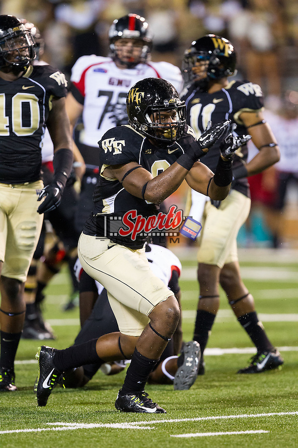 Wake Forest Demon Deacons linebacker Marquel Lee (8) reacts after making a play during second half action against the Gardner-Webb Runnin' Bulldogs at BB&T Field on September 6, 2014 in Winston-Salem, North Carolina.  The Demon Deacons defeated the Runnin' Bulldogs 23-7.   (Brian Westerholt/Sports On Film)
