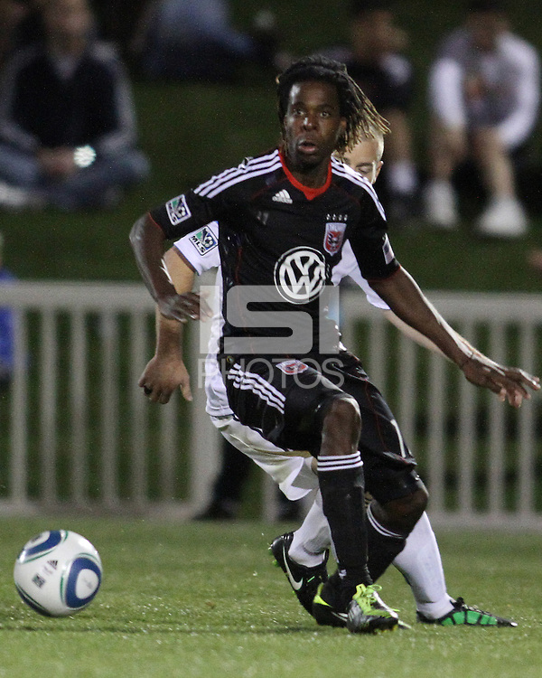 Joseph Ngwenya(11) of D.C. United pushes the ball away from Jordan Harvey(2) of the Philadelphia Union during a play-in game for the US Open Cup tournament at Maryland Sportsplex, in Boyds, Maryland on April 6 2011. D.C. United won 3-2 after overtime penalty kicks.
