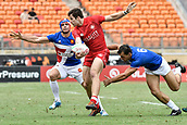 2nd February 2019, Spotless Stadium, Sydney, Australia; HSBC Sydney Rugby Sevens; Canada versus France; Matt Mullins of Canada runs through the tackles of Manoel Dall'igna and Paulin Riva of France