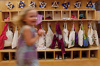 A young girl runs by book bags in the hallway of the Alexander Moksel kindergarten in Munich, Germany. The school is part of the Jewish community of Munich and Upper Bavaria which creates an environment to foster a new generation of Jewish education.