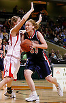 SIOUX CITY, IA - MARCH 13, 2009 --  Hillary Stucky #33 of Sterling College drives on Randa Hulstein #42 of Northwestern College (IA) during their game at the 2009 NAIA DII Women's Basketball National Championship at the Tyson Events Center. (Photo by Dick Carlson/Inertia)