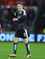 Jamie Vardy of Leicester City celebrates his sides second goal during the Barclays Premier League match between Swansea City and Leicester City played at The Liberty Stadium on 5th December 2015