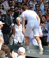 OIC - ENTSIMAGES.COM -  Andy Murray of Great Britain celebrates his win with his mother Judy Murray in the Gentlemen's Singles Final match against Novak Djokovic of Serbia of the Wimbledon Lawn Tennis Championships at the All England Lawn Tennis and Croquet Club 7th July 2013     Photo Ents Images/OIC 0203 174 1069