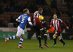 Leon Clarke of Sheffield Utd tussles with Scott Laird of Walsall during the English League One match at Bramall Lane Stadium, Sheffield. Picture date: November 29th, 2016. Pic Simon Bellis/Sportimage