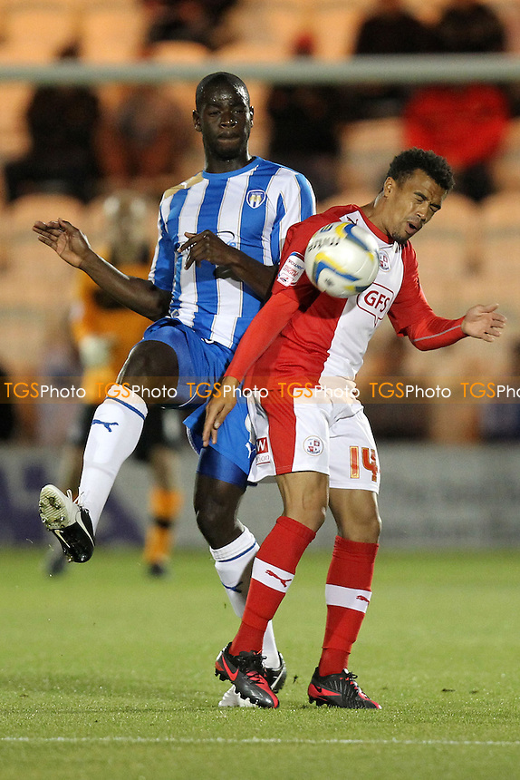Magnus Okuonghae of Colchester United and Nicky Ajose of Crawley Town - Colchester United vs Crawley Town - NPower League One Football at the Weston Homes Community Stadium, Colchester, Essex - 18/09/12 - MANDATORY CREDIT: Gavin Ellis/TGSPHOTO - Self billing applies where appropriate - 0845 094 6026 - contact@tgsphoto.co.uk - NO UNPAID USE.