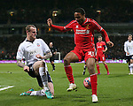 David Wheater of Bolton Wanderers tackles Raheem Sterling of Liverpool - FA Cup Fourth Round replay - Bolton Wanderers vs Liverpool - Macron Stadium  - Bolton - England - 4th February 2015 - Picture Simon Bellis/Sportimage