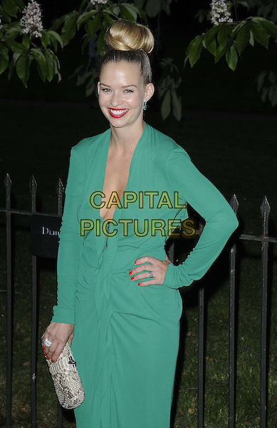 Melissa Herber.Serpentine Galley Summer Party, Kensington Palace Gardens, London, England..26th June 2012.half length green dress snakeskin clutch bag beige hair up bun low cut neckline cleavage hand on hip.CAP/CAN.©Can Nguyen/Capital Pictures.