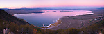 A panorama photo of Mono Lake from above at sunset.