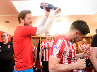 Lincoln City's Josh Vickers, left, and Tom Pett celebrate after winning the league<br /> <br /> Photographer Chris Vaughan/CameraSport<br /> <br /> The EFL Sky Bet League Two - Lincoln City v Tranmere Rovers - Monday 22nd April 2019 - Sincil Bank - Lincoln<br /> <br /> World Copyright © 2019 CameraSport. All rights reserved. 43 Linden Ave. Countesthorpe. Leicester. England. LE8 5PG - Tel: +44 (0) 116 277 4147 - admin@camerasport.com - www.camerasport.com