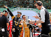 May 28, 2017; Indianapolis, IN, USA; IndyCar Series driver James Hinchcliffe (left) and Helio Castroneves dance alongside a DJ during driver introductions prior to the 101st Running of the Indianapolis 500 at Indianapolis Motor Speedway. Mandatory Credit: Mark J. Rebilas-USA TODAY Sports