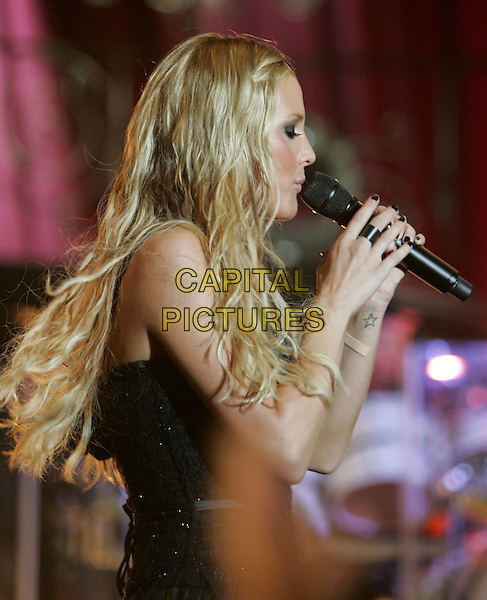 "ASHLEE SIMPSON.Live during her ""Love Tour"" at The Greek Theatre in Los Feliz, California, USA.  .June 7th, 2006.Ref: DVS.concert gig performance stage music black half length singing profile.www.capitalpictures.com.sales@capitalpictures.com.Supplied By Capital PIctures"