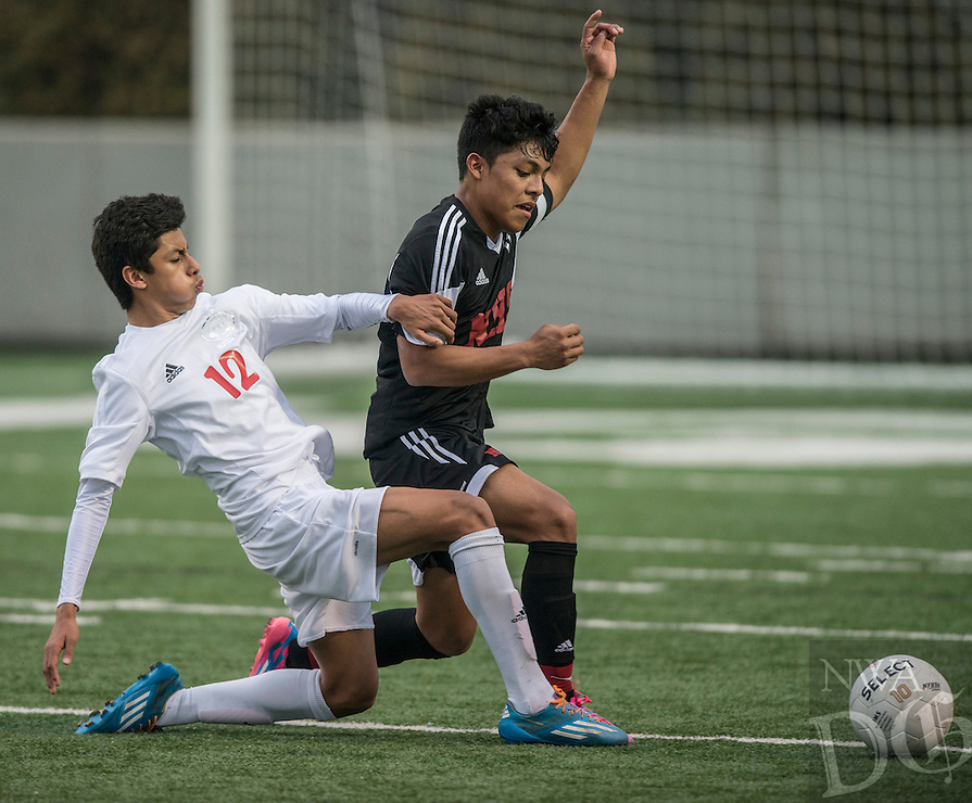 NWA Democrat-Gazette/ANTHONY REYES • @NWATONYR<br /> Salvador Gonzalez (12), Springdale freshman, attacks the ball against Fort Smith Northside Thursday, March 19, 2015 at Bulldog Stadium in Springdale. The Bulldogs won on penalty kicks after a 2-2 tie at the end of regulation.
