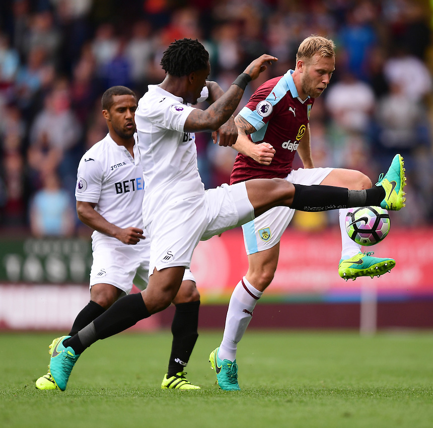 Burnley's Scott Arfield vies for possession with Swansea City's Leroy Fer<br /> <br /> Photographer Chris Vaughan/CameraSport<br /> <br /> Football - The Premier League - Burnley v Swansea City - Saturday 13th August 2016 - Turf Moor - Burnley<br /> <br /> World Copyright &copy; 2016 CameraSport. All rights reserved. 43 Linden Ave. Countesthorpe. Leicester. England. LE8 5PG - Tel: +44 (0) 116 277 4147 - admin@camerasport.com - www.camerasport.com