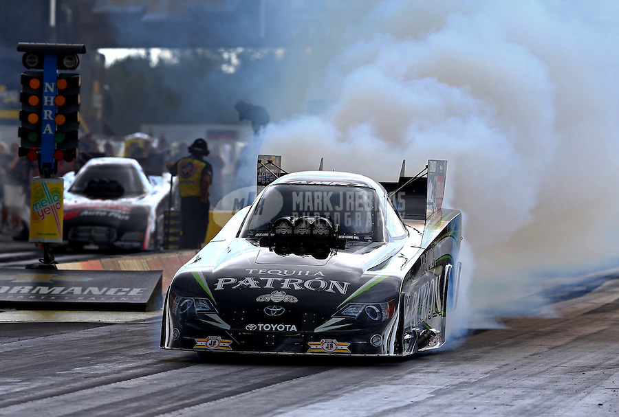 Aug. 31, 2013; Clermont, IN, USA: NHRA funny car driver Alexis DeJoria during qualifying for the US Nationals at Lucas Oil Raceway. Mandatory Credit: Mark J. Rebilas-
