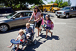 Sharon Ferrell picks up her older twin girls, Bea, right, Vivian, center, while carting around her youngest set of twins, Ivy, left, and James, second from left, in Lincoln, CA  May 13, 2009.