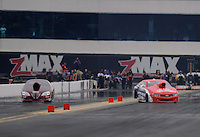 Sept. 16, 2012; Concord, NC, USA: NHRA pro stock driver Shane Gray (right) loses control alongside Warren Johnson during the O'Reilly Auto Parts Nationals at zMax Dragway. Gray would be uninjured. Mandatory Credit: Mark J. Rebilas-