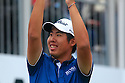Byeong-Hun An of Korea salutes the crowd during the final round of the BMW PGA Championship played over the West Course at the Wentworth Club on 24th May 2015 in Virginia Water, Surrey, England. Picture Credit / Phil INGLIS