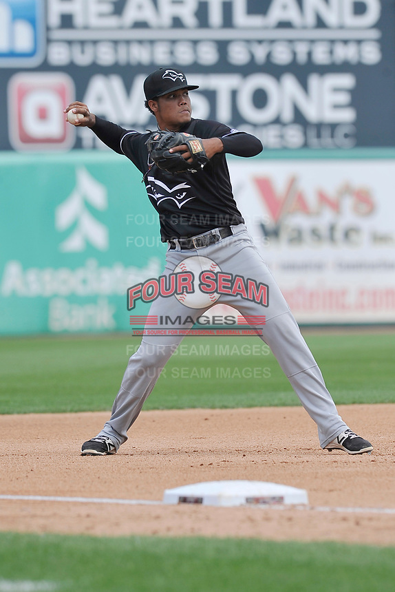 Quad Cities River Bandits third baseman Wander Franco (4) throws to first base during a game against the Wisconsin Timber Rattlers at Fox Cities Stadium on June 27, 2017 in Appleton, Wisconsin.  Wisconsin lost 6-5.  (Dennis Hubbard/Four Seam Images)
