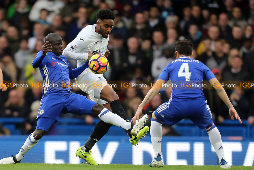 Leroy Fer of Swansea City and Cesc Fabregas and Ngolo Kante of Chelsea during Chelsea vs Swansea City, Premier League Football at Stamford Bridge on 25th February 2017
