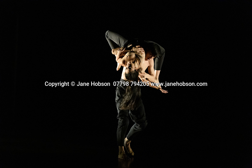 "London, UK. 04.11.2019. Rambert2 presents ""Sin"", at Sadler's Wells theatre, choreographed by Sidi Larbi Cherkaoui and Damien Jalet, with lighting design by Adam Carree and costume design by Alexandra Gilbert. Picture shows: Melody Tamiz and Chen Peng. Photograph © Jane Hobson."