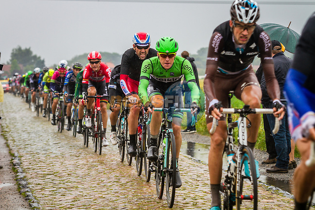 Bunch on the cobbles, Tour de France, Stage 5: Ypres > Arenberg Porte du Hainaut, UCI WorldTour, 2.UWT, Wallers, France, 9th July 2014, Photo by Thomas van Bracht / Peloton Photos