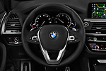 Car pictures of steering wheel view of a 2019 BMW X3 M Sport 5 Door SUV