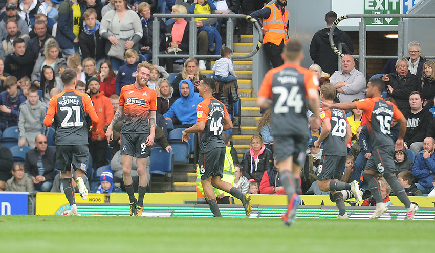 Swansea City's Oli McBurnie (second left) celebrates scoring his side's second goal with team-mates<br /> <br /> Photographer Kevin Barnes/CameraSport<br /> <br /> The EFL Sky Bet Championship - Blackburn Rovers v Swansea City - Sunday 5th May 2019 - Ewood Park - Blackburn<br /> <br /> World Copyright © 2019 CameraSport. All rights reserved. 43 Linden Ave. Countesthorpe. Leicester. England. LE8 5PG - Tel: +44 (0) 116 277 4147 - admin@camerasport.com - www.camerasport.com