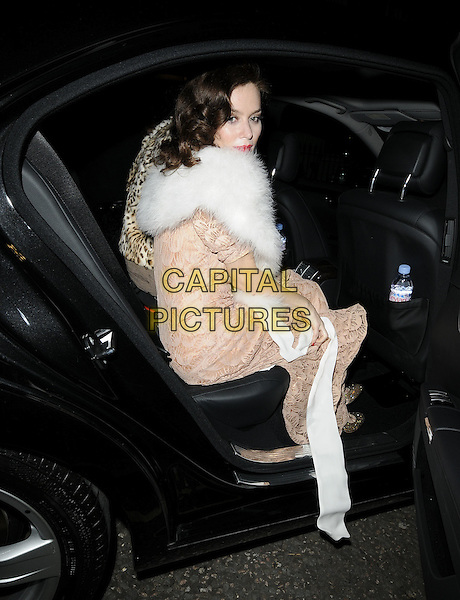 "ANNA FRIEL.Seen leaving the theatre after an evening performance of ""Breakfast At Tiffany's', Theatre Royal Haymarket, London, England, UK,.November 19th 2009. .full length white fur shrug jacket peach beige long maxi dress gold shoes pattern vintage sitting getting into car sheer crochet lace see through thru .CAP/CAN.©Can Nguyen/Capital Pictures."